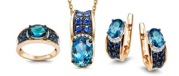 Komplet biżuterii z topazami london blue, szafirami i brylantami.